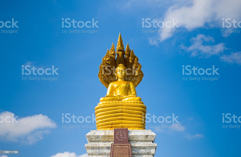 Gold buddha statue in sky background royalty-free stock photo