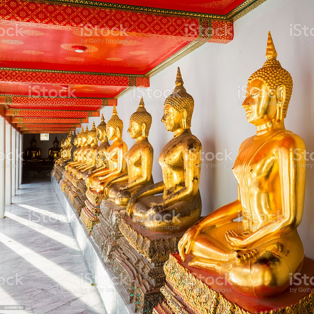 gold buddha statue in thailand stock photo