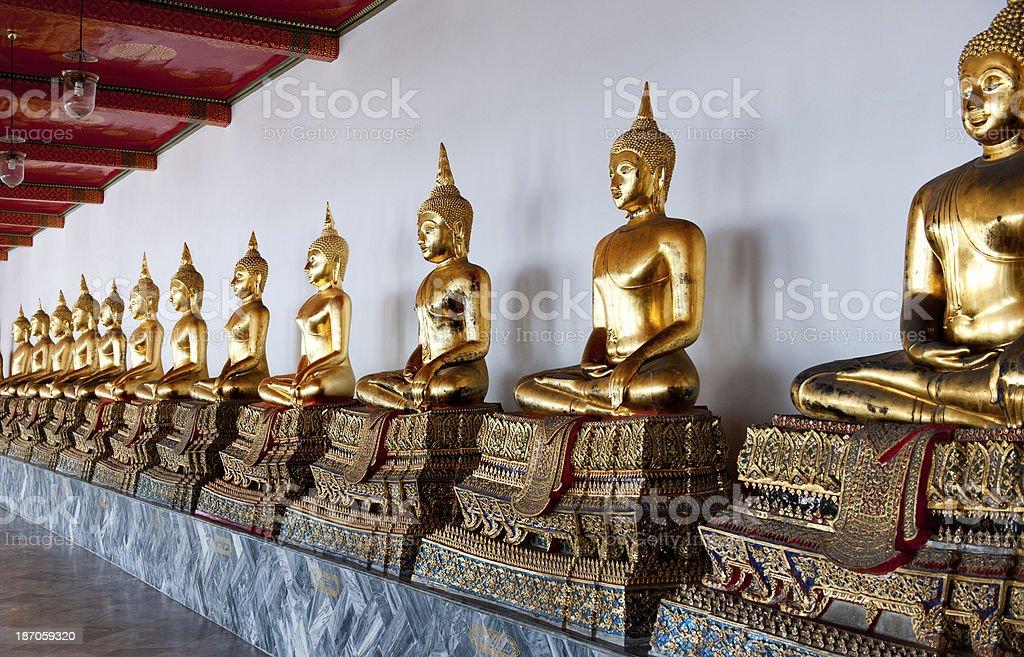 gold Buddha statues in Wat Arun temple Bangkok Thailand royalty-free stock photo
