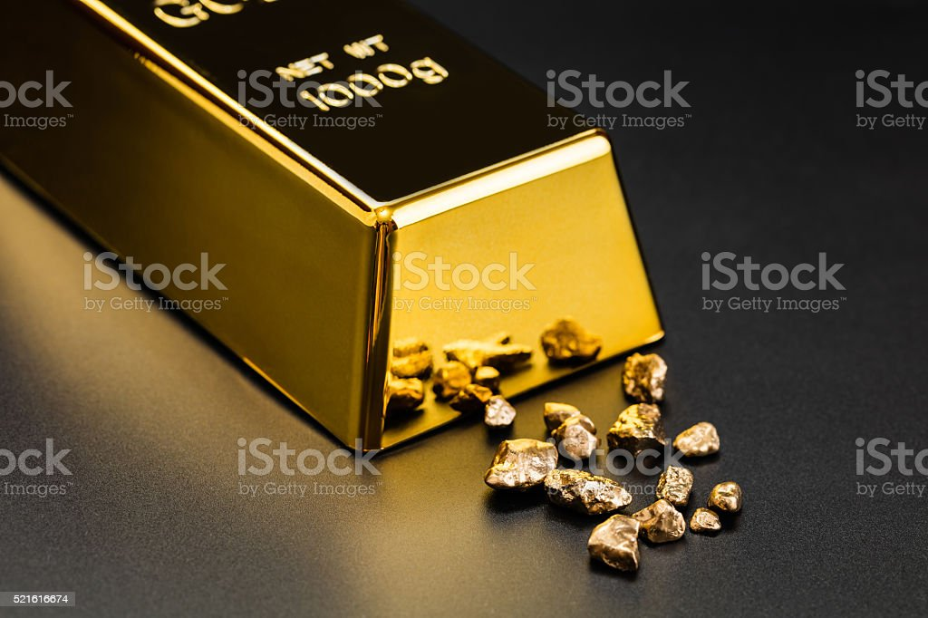 gold bullion and nuggets stock photo