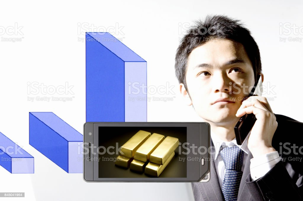 Gold bullion to the businessman and mobile screen stock photo