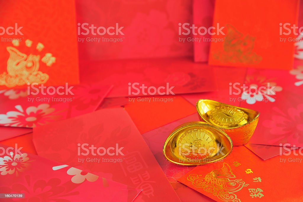 Gold Bullion with Red Envelope Background royalty-free stock photo