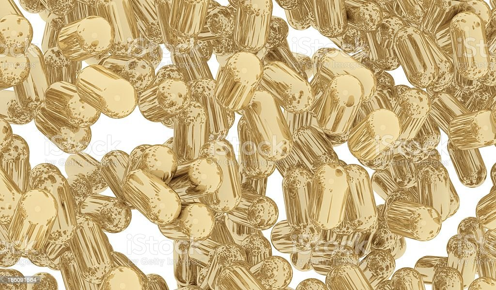 Gold capsule royalty-free stock photo
