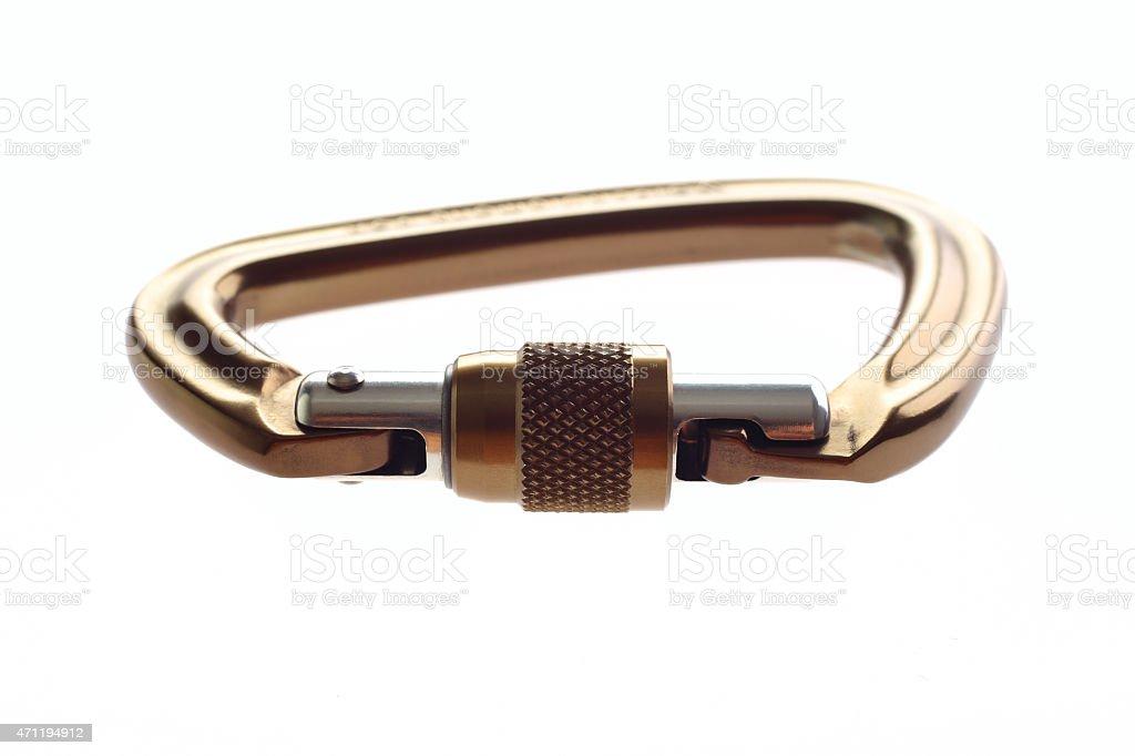 Gold carabiner stock photo
