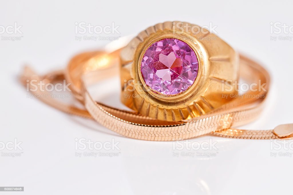 gold chain and gold ring with ruby stock photo