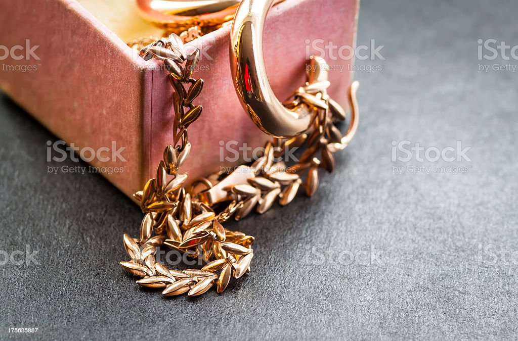 Gold chain in a box. royalty-free stock photo