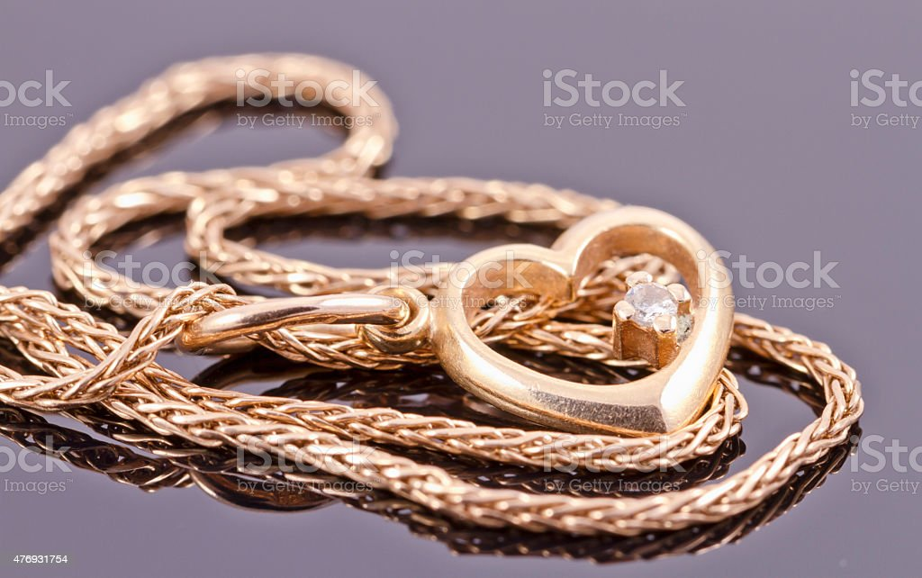 Gold chain with pendant in the shape of a heart stock photo