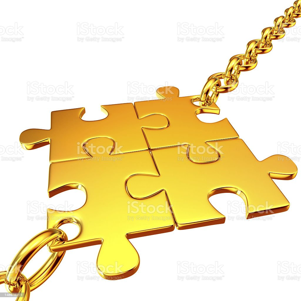 Gold chains with the collected puzzles royalty-free stock photo
