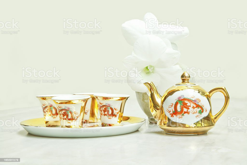Gold chinese tea set royalty-free stock photo