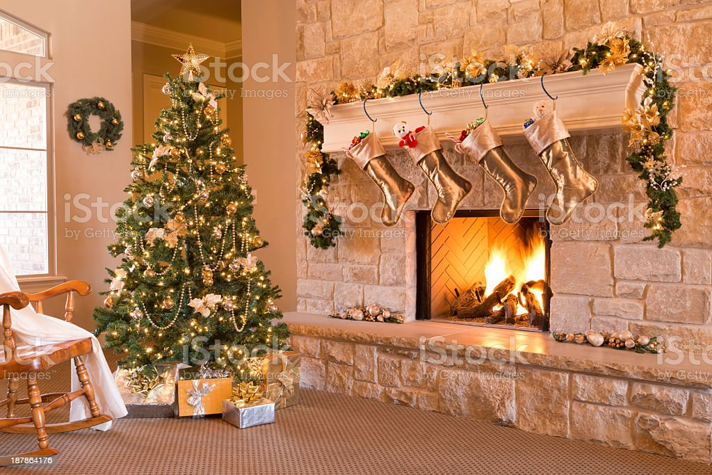 Gold Christmas: morning, tree, gifts, fireplace, stockings, mantel, hearth, wreath stock photo