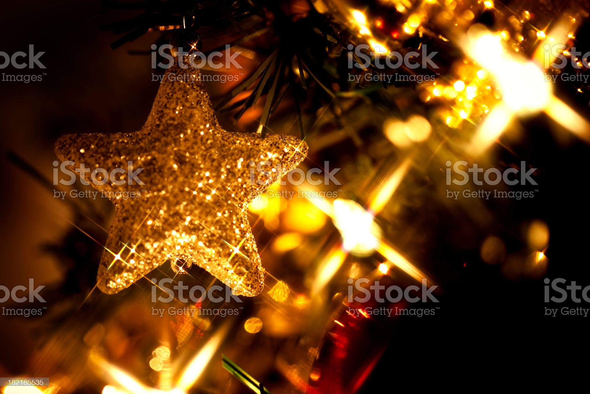 Gold Christmas star decoration on a tree  royalty-free stock photo