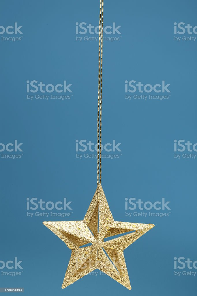 Gold Christmas Star on Blue stock photo