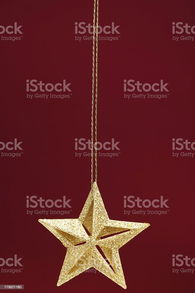 Gold Christmas Star on Red stock photo