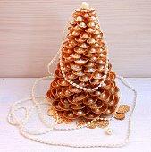Gold Christmas tree made of shells