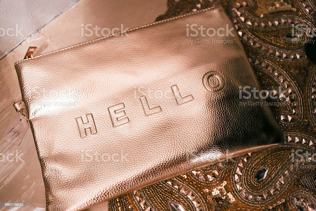 Gold clutch with Hello text stock photo