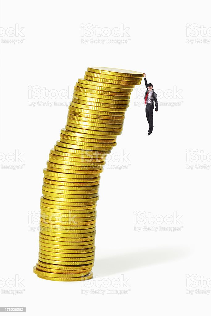 Gold coin heap almost collapse royalty-free stock photo