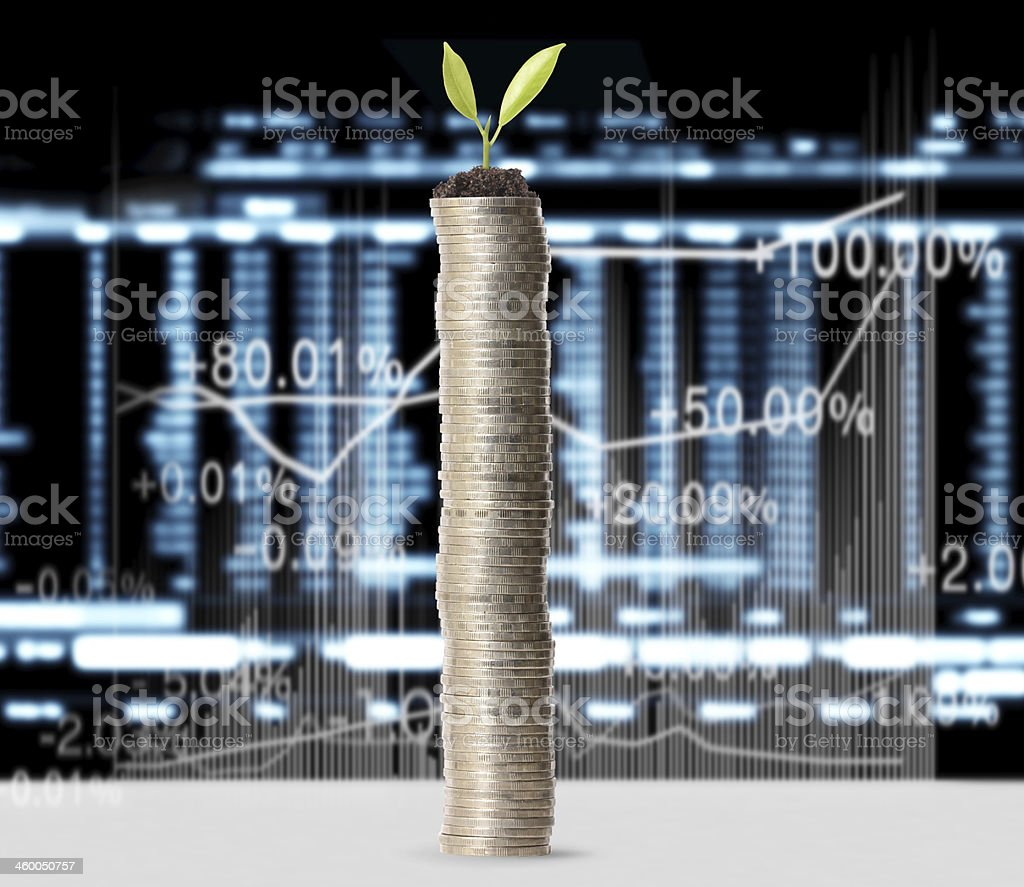 gold coins and graph them stock photo