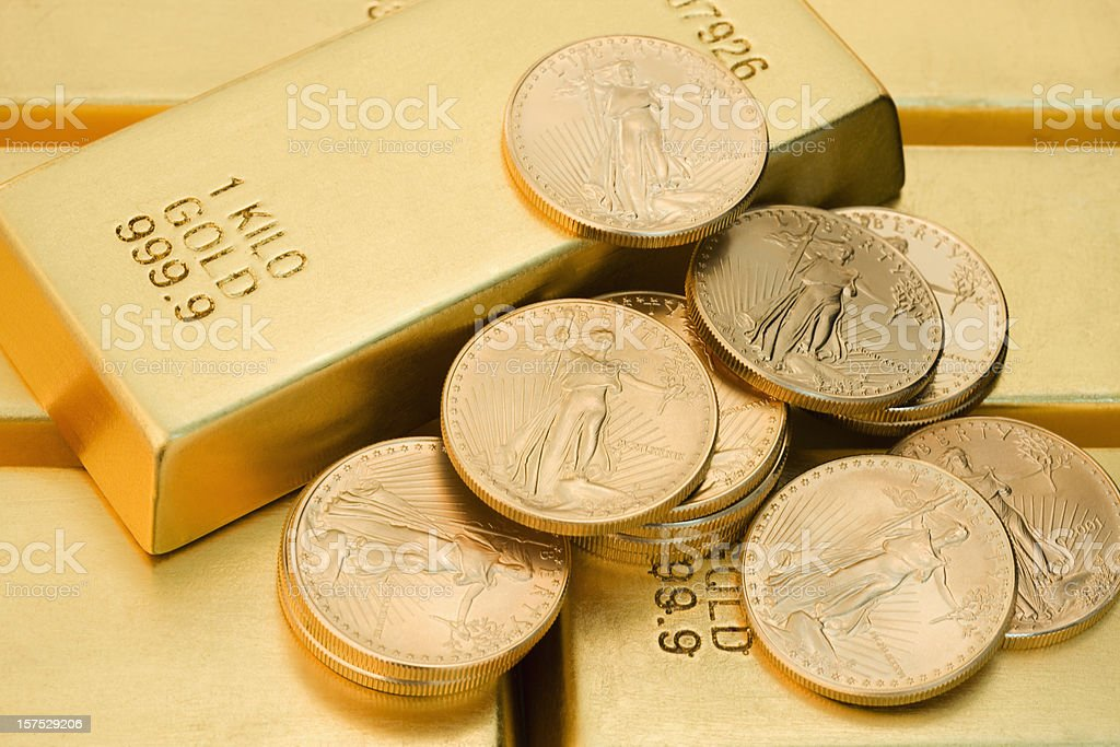 Gold Coins and Ingots. royalty-free stock photo