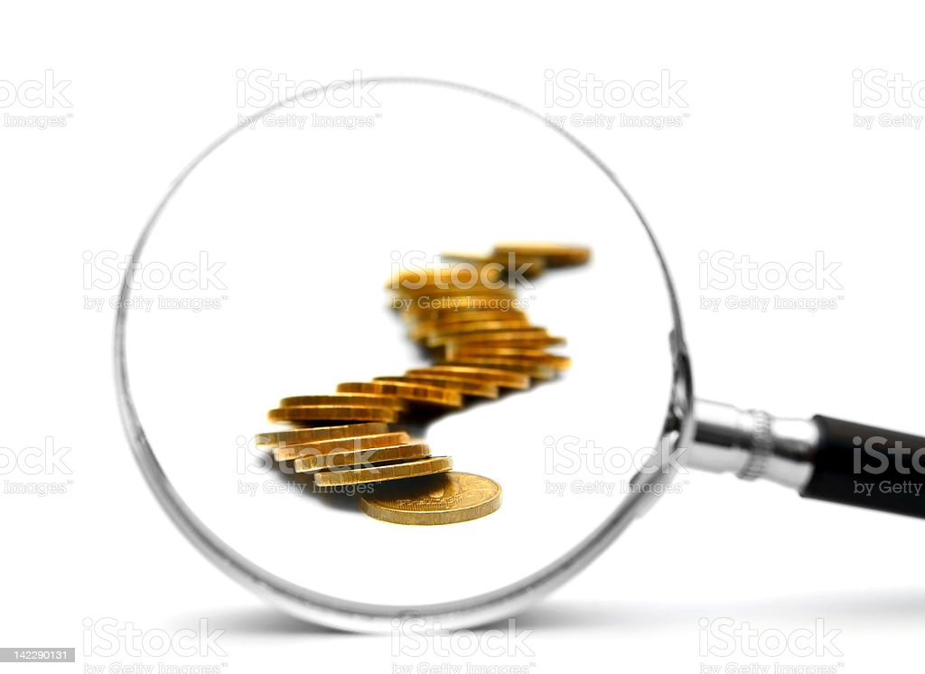 Gold coins and magnifier. On white background. stock photo
