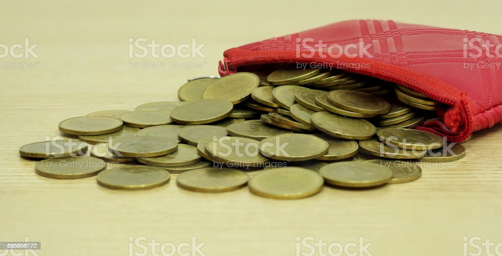 Gold coins from small coin leather pocket stock photo