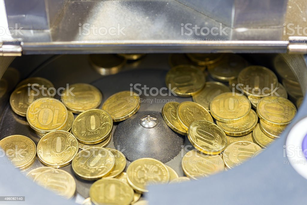 Gold coins in a counting machine stock photo