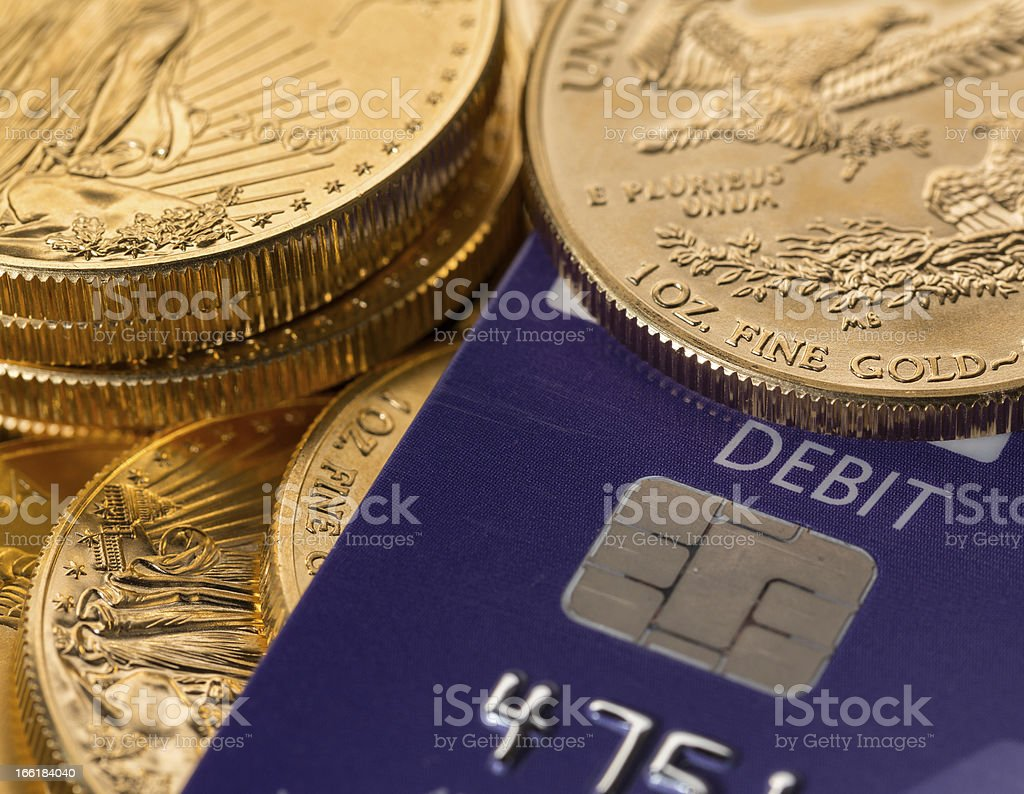 Gold coins on chip and pin debit card royalty-free stock photo
