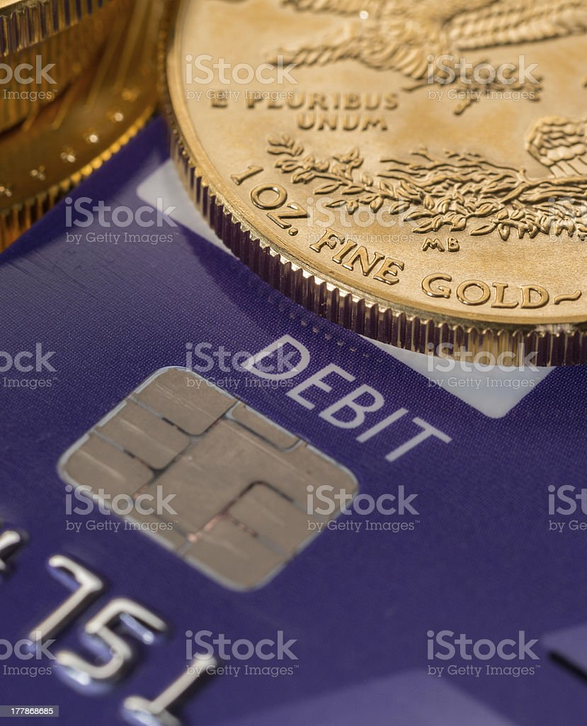Gold coins on chip and pin debit card stock photo