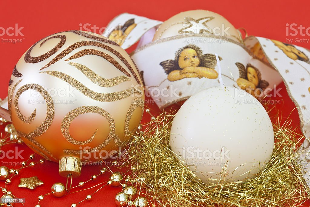 Gold Coloured Christmas Baubles & Candle royalty-free stock photo