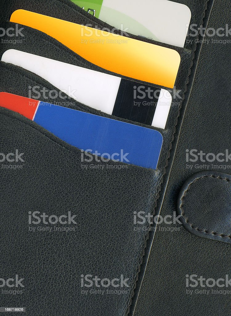 Gold credit card in the wallet royalty-free stock photo