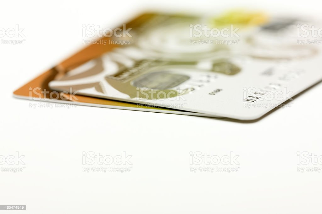 Gold credit cards isolated on white background stock photo