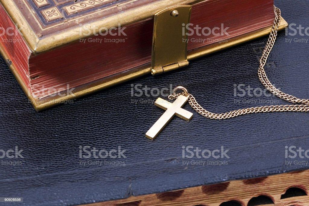Gold Cross on Bible stock photo