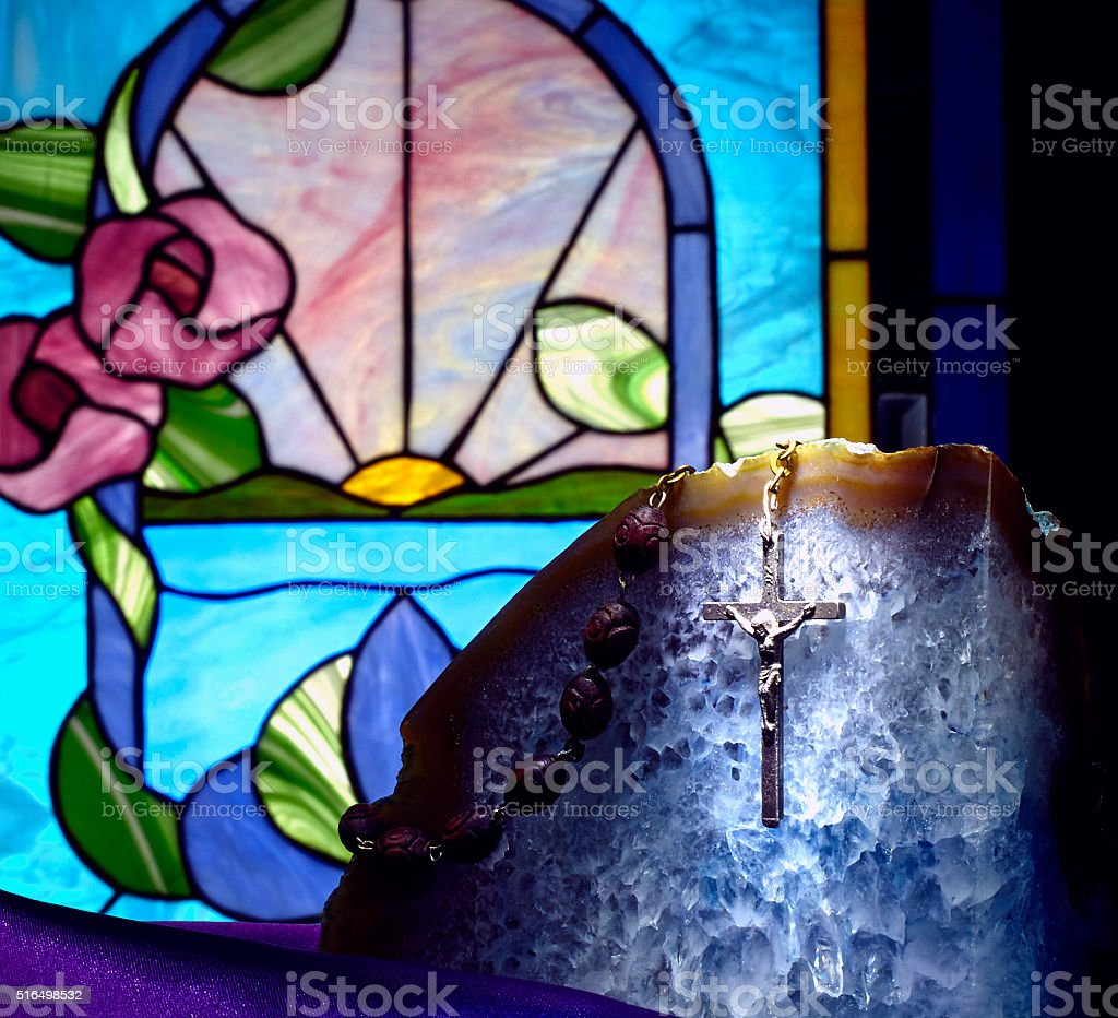 Gold Cross on Crystal with Stained Glass Window stock photo