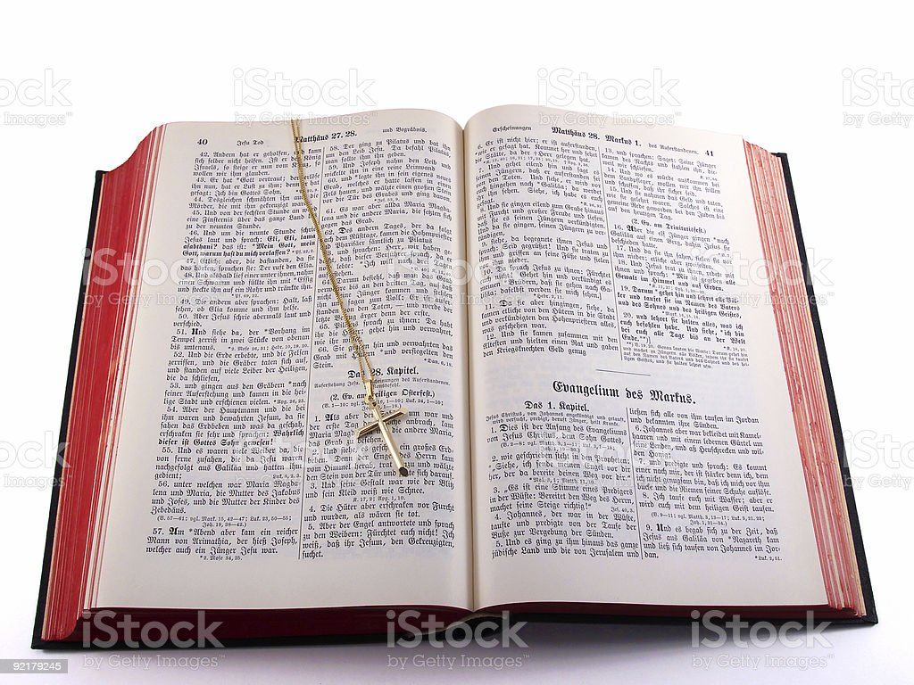 Gold cross on old German Bible royalty-free stock photo