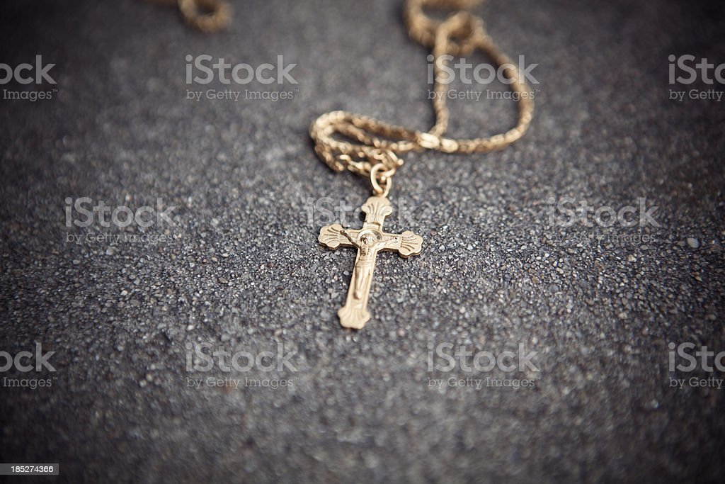 Gold cross on the floor royalty-free stock photo