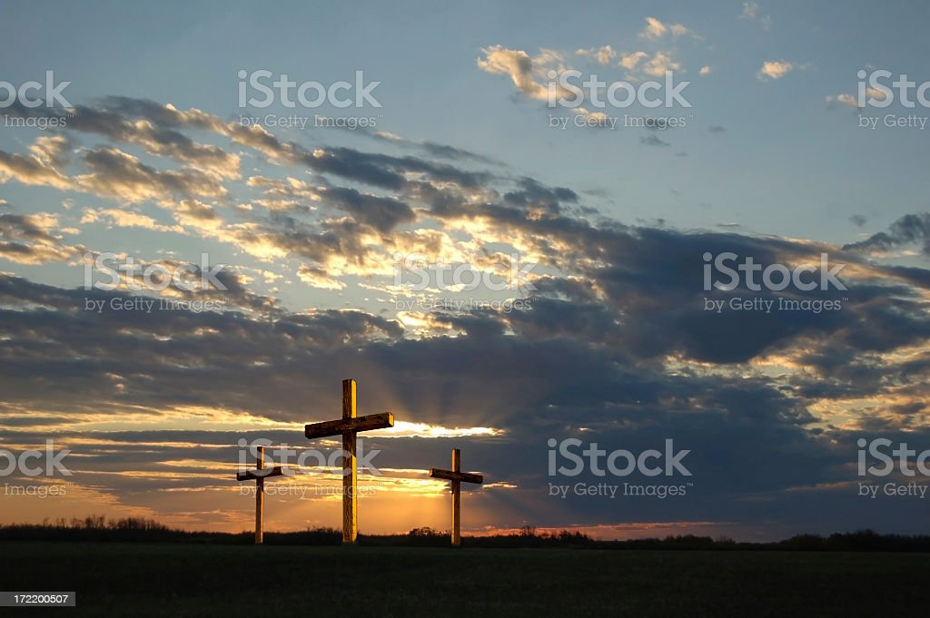 Gold Crosses at Dusk 0n Good Friday with dramatic sky royalty-free stock photo