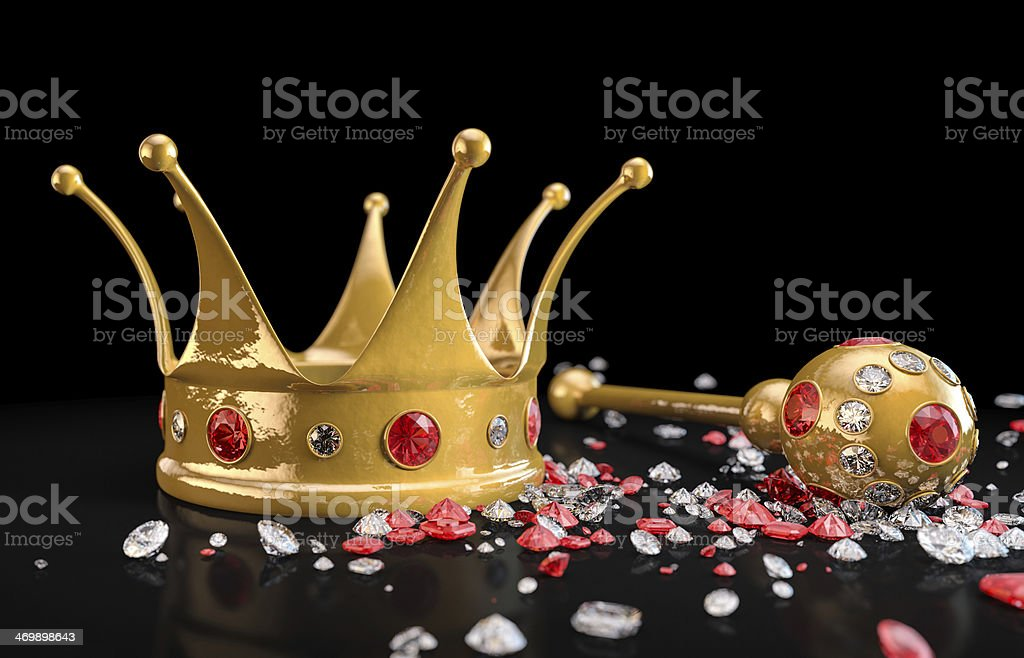 Gold crown and scepter with rubies, diamonds on black surface stock photo