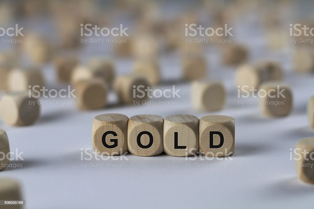 gold - cube with letters, sign with wooden cubes stock photo