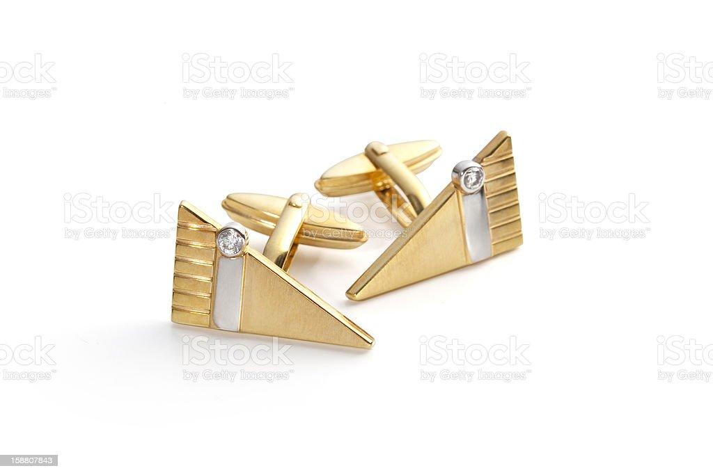 Gold cufflinks with diamaonds and whitegold stripe stock photo