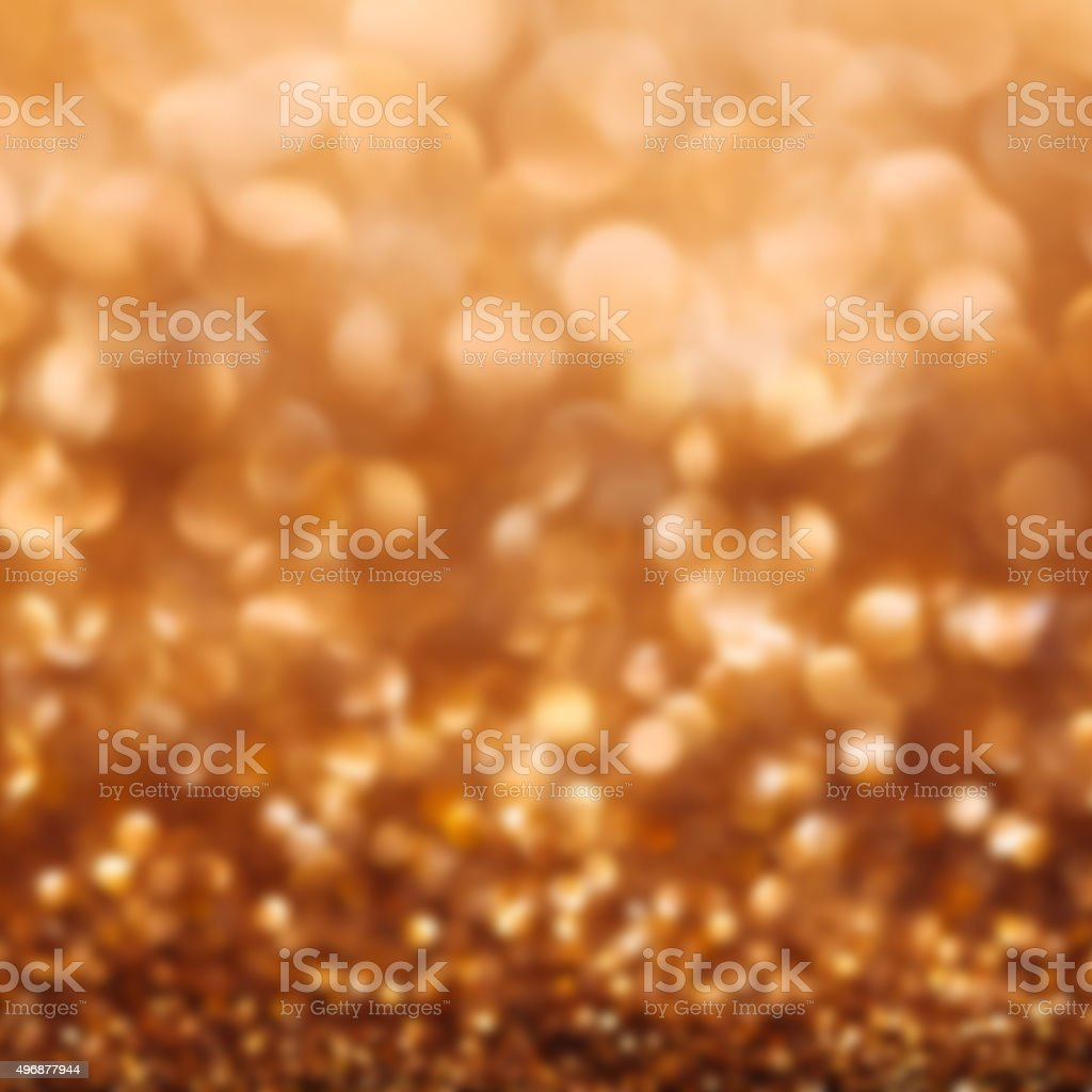 Gold defocused glitter background with copy space stock photo