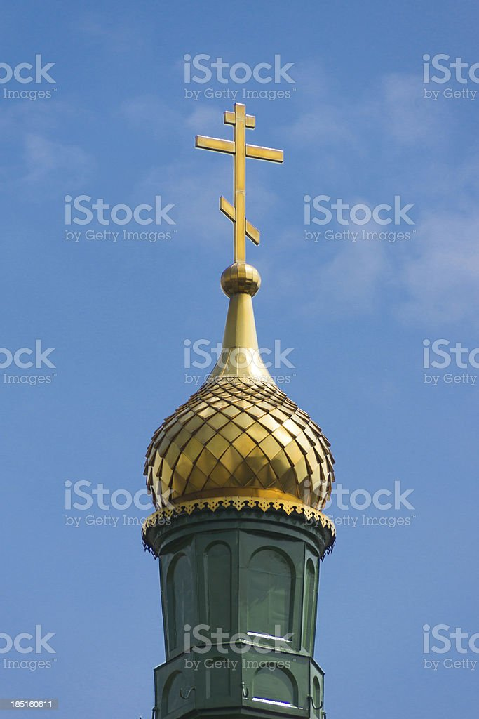Gold dome and cross of Christian belief royalty-free stock photo