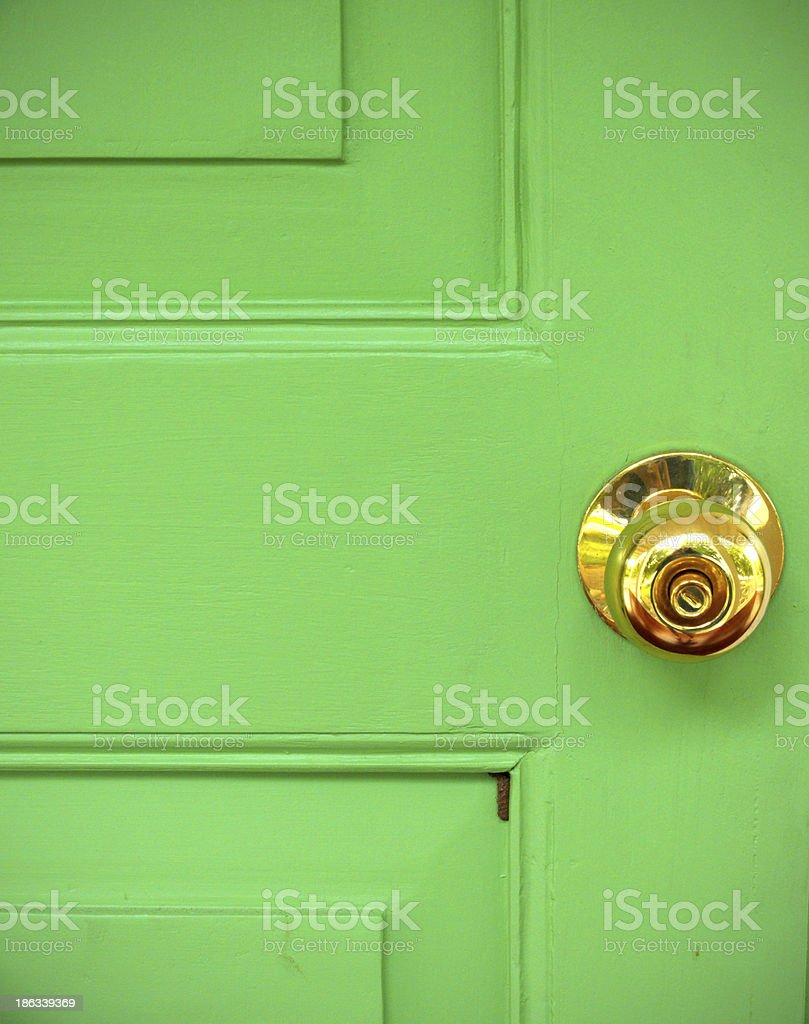 Gold door knob on green royalty-free stock photo