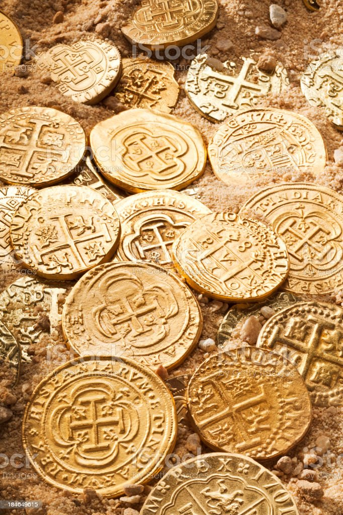 Gold Doubloons in Sand stock photo