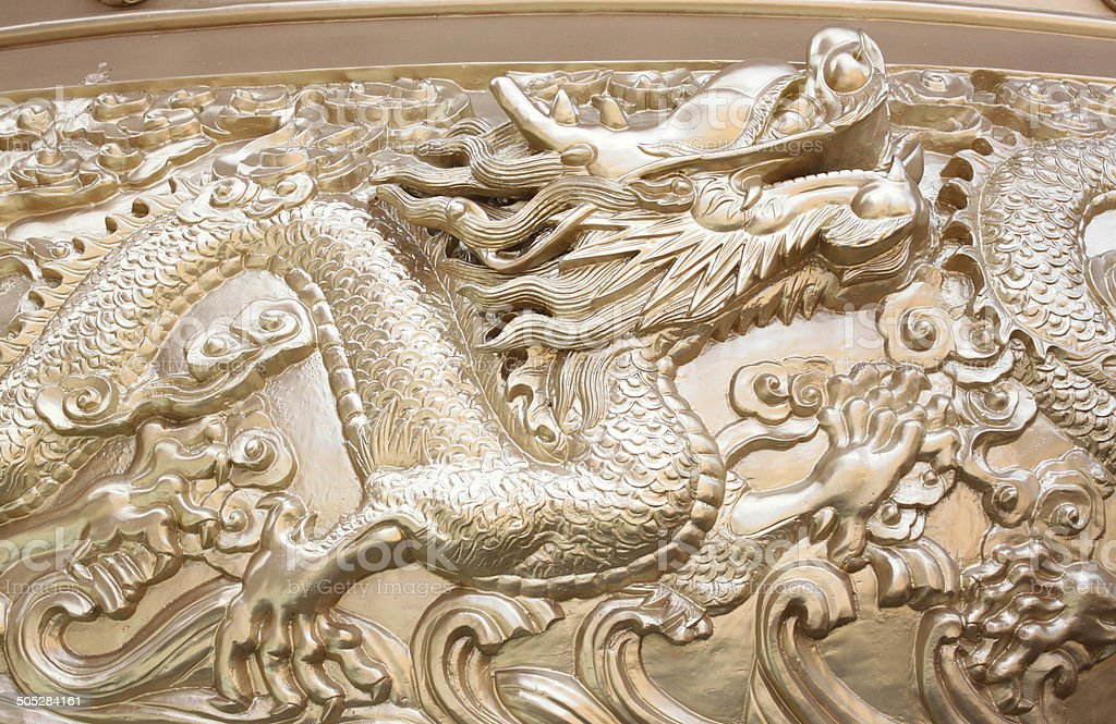 Gold dragon sculpture in the Chinese temple. royalty-free stock photo