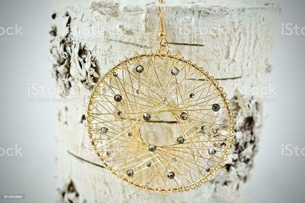 Gold Dream catcher earring stock photo