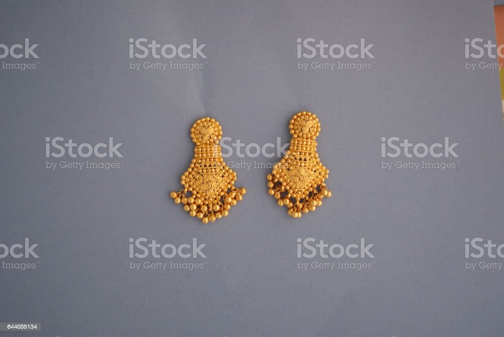 Gold earring with dangling beads stock photo