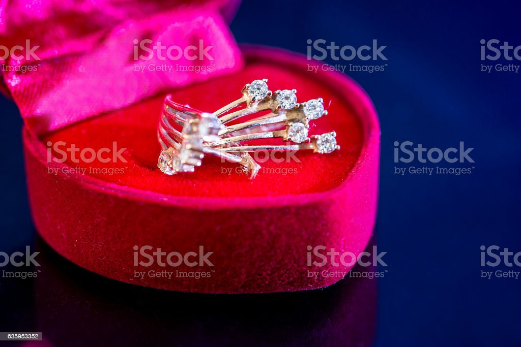 gold earrings stud  in red box isolated. stock photo