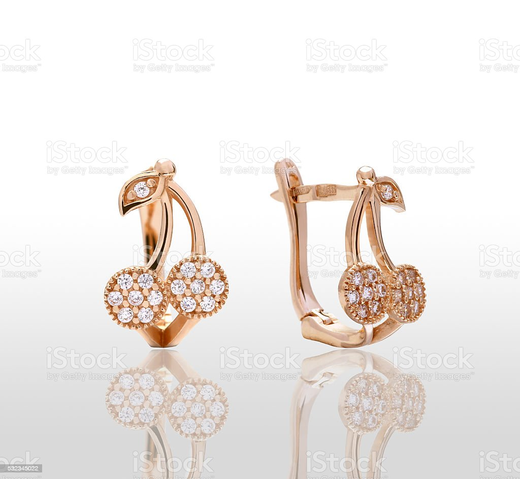 gold earrings with precious stones royalty-free stock photo