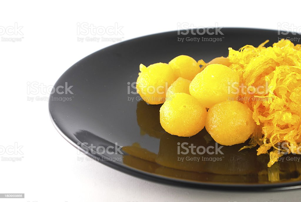 Gold egg yolks drops and pinched royalty-free stock photo