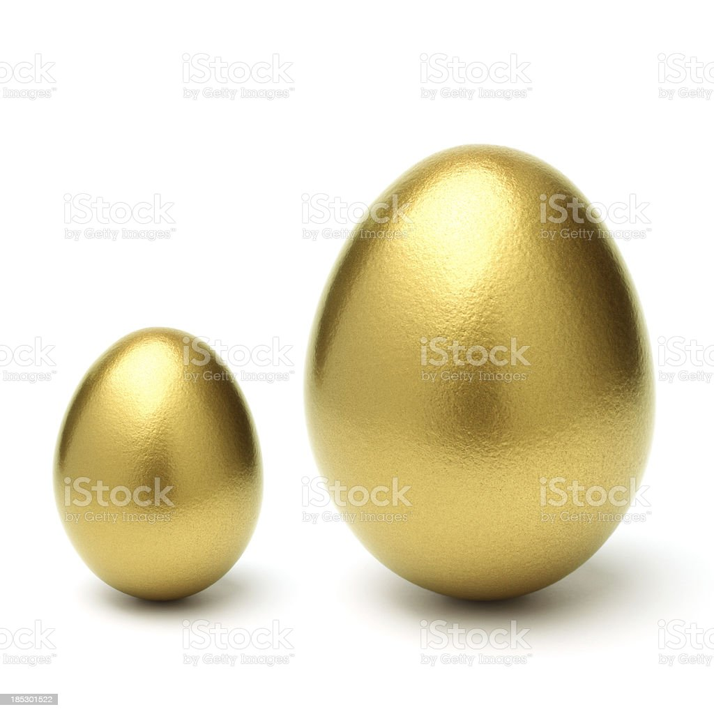 Gold Eggs Grow From Small to Large on White Background royalty-free stock photo