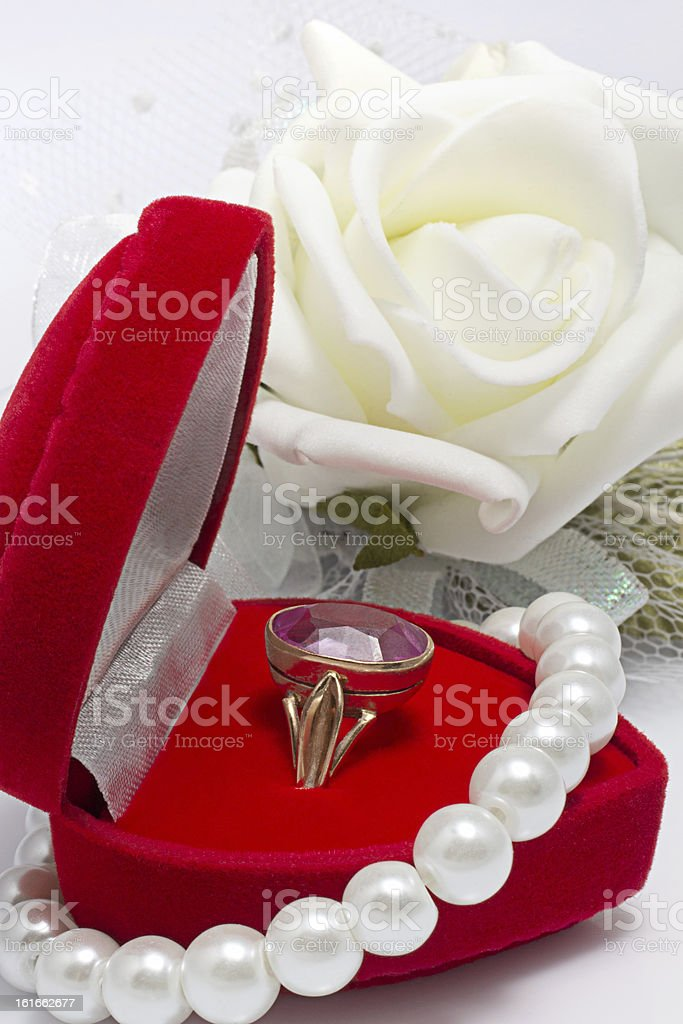 Gold engagement ring with gemstone in red box and rose royalty-free stock photo